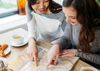 Friends serching for directions on a map
