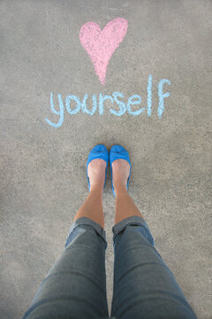 Female in blue flats and jeans above a message that says Love Yourself