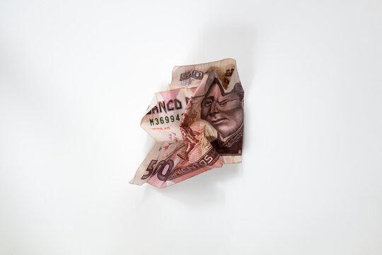Wrinkled 500 pesos bill