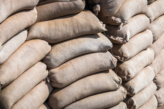 background made of sandbags to protect military and civilian objects. For protection from bullets and shrapnel, natural disasters, hurricanes, flooding, etc.