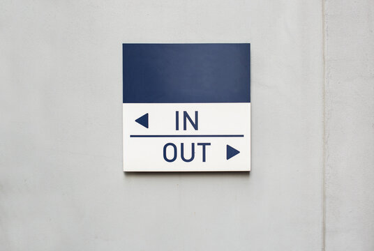 IN OUT Sign on the Wall