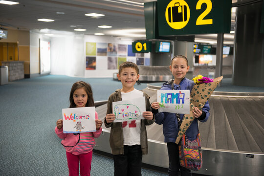 Kids With Welcome Signs At Airport