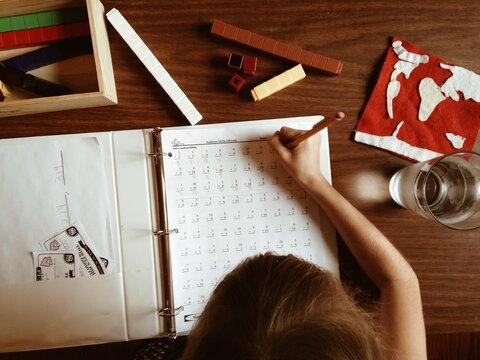 Young girl working on math homework for homeschool