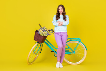 Full body size photo of charming pretty young girl standing near vintage extraordinary bicycle...