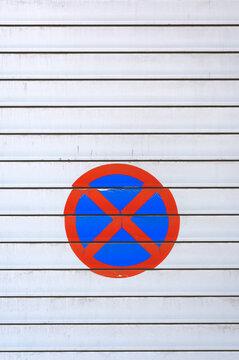 No parking sign on white garage doors