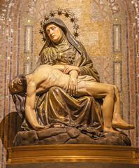 BARCELONA, SPAIN - MARCH 5, 2020: The carved polychrome sculpture of Pieta (Deposition) in the church Iglesia Santa Maria de Gracia de Jesus.