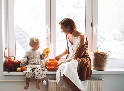Happy family preparing for Halloween at home together.