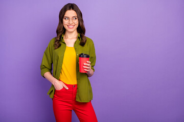Portrait of cute nice pretty content girl enjoy summer free time hold hot cacao beverage takeaway cup look copyspace wear casual style clothes isolated over violet color background