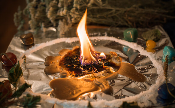 Candle for cleansing a person, magic rituals and wax casting, energy cleansing. Altar of modern witch.