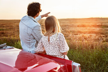 Rear view of couple during a date at sunset