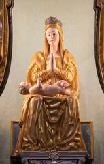 RIVA DEL GARDA, ITALY - JUNE 13, 2019: The polychrome carved statue of Madonna in church Chiesa di Santa Maria Assunta by unknown artist.