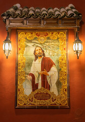 CORDOBA, SPAIN - MAY 26, 2015: The ceramic tiled, Jesus in Gethsemane garden on the facade of house on the Compas de San Francisco square by C. J. Soriano (2007).