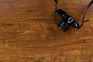 View of a camera on wood table background
