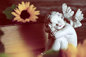 Guardian angel figurine and sunflowers