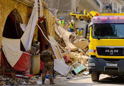 Volunteers dig through the rubble of a collapsed building after signs of life were detected in Beirut