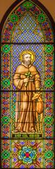 BARCELONA, SPAIN - MARCH 3, 2020: The Saint Gil Abad on the windowpane in the church Parroquia de la Mare de Deu de Nuria.