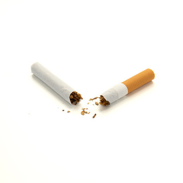 Broken cigarette in half with orange filter, isolated on white background. Do not smoke. Smoking is harmful. Healthy lifestyle concept. Close-up square photo.