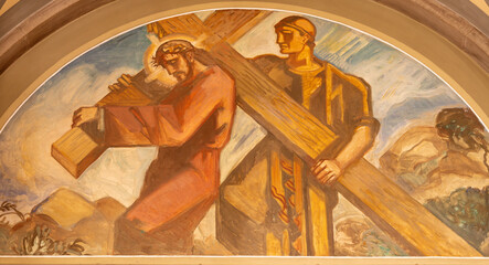 BARCELONA, SPAIN - MARCH 3, 2020: The fresco Simon of Cyrene helps Jesus carry the cross in the church Santuario Nuestra Senora del Sagrado Corazon by Francesc Labarta (1960).