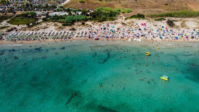 Aerial view of the Pescoluse Beach, aka Maldives of Salento, in the south of Italy - Apulian beach with turquoise waters in summer - Idyllic holiday destination along the Ionian Sea