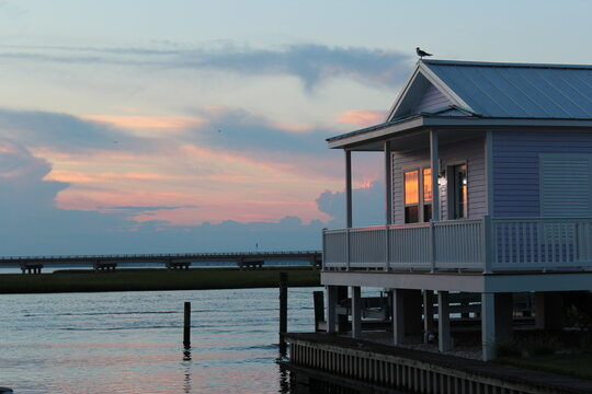 Purple Cotton Candy Sunset on the Water During Summer in Chincoteague, Virginia