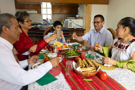 A Mexican family toasting