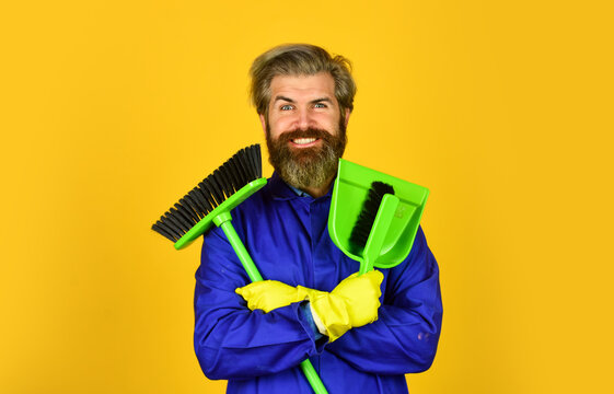 Cleaning day. Cleaning agency. Worker with brush. Cleaning equipment. Yardman occupation. Garbage removal. Janitor professional. Bearded hipster blue uniform with broom. Gardener cleaning service man