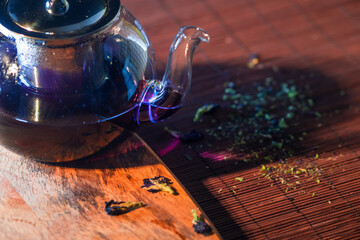 Blue Thai tea in a glass teapot. Freshly brewed tea, delicious and healthy hot drink. Hot drink on...