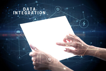 Holding futuristic tablet with DATA INTEGRATION inscription, cyber security concept