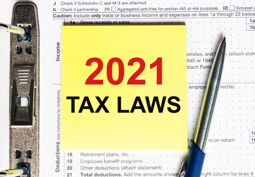 Yellow paper with text 2021 tax laws