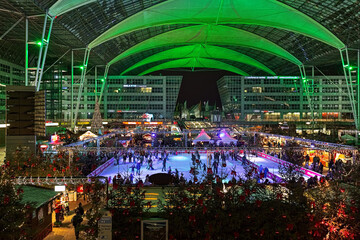 Munich, Germany. Christmas and Winter Market with ice rink in the Munich Airport Center Forum between the airport terminals.