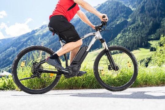 Man Riding Electric Mountain Bike