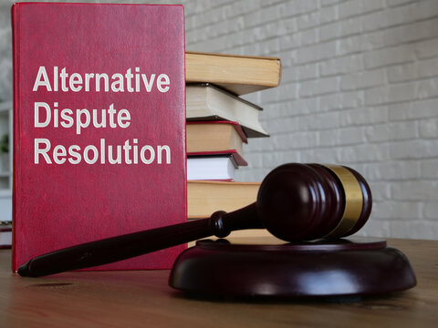Alternative dispute resolution ADR is shown on the conceptual business photo