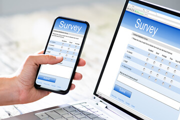 Close-up Of A Businesswoman Hand Filling Online Survey