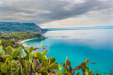 coast in southern italy with cloudy sky and turquoise water Fotomurales