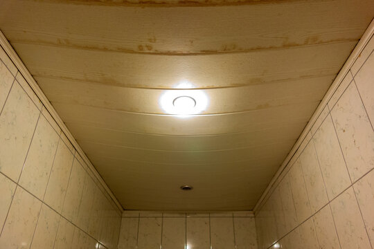 Leaking plastic ceiling with water stains