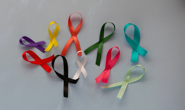 colorful ribbons on light blue background, cancer awareness, world cancer day, national cancer survivor day, world autism awareness day