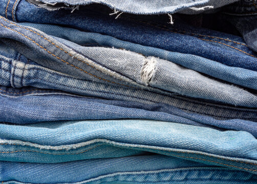 A pile of old blue jeans ready to be recycled in the circular economy.