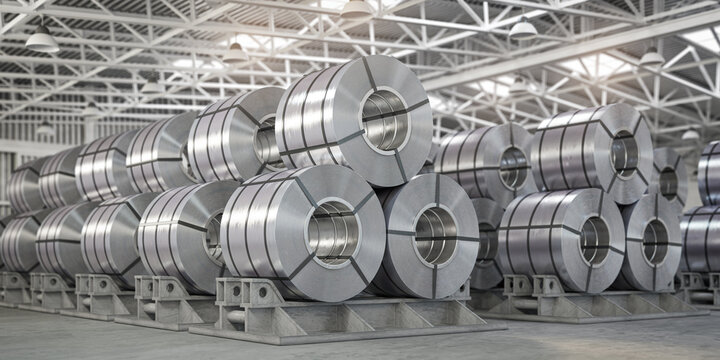 Rolls of metal sheet. Zinc, aluminium or steel sheet rolls on warehouse in factory.