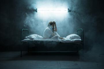 Foto auf Leinwand Vogel auf Asten Depressed psycho woman sitting in bed, insomnia