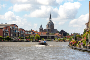 A sloop sails over the old Rijn near the South-Holland village of Leiderdorp in the Netherlands.