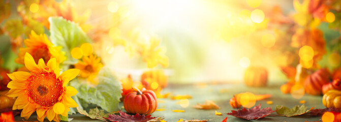 Autumn festive background with sunflowers, pumpkins and fall leaves. Concept of Thanksgiving day or Halloween with copy space