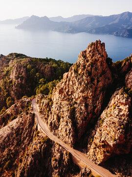 """Calanques de Piana"" badlands and scenic road on the sea, Corse, France"