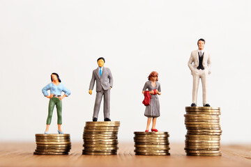 Fototapeta Conceptual image of gender inequality. A women and a men with income difference