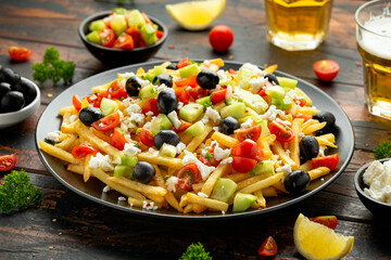 Loaded potato Vegan Fries with tomato, cucumber, olives and feta cheese