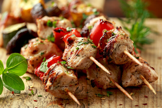 Chicken kebab, BBQ, skewers with mushrooms, red sweet pepper, zucchini and beer. Party food