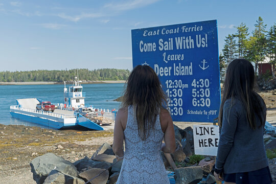 A private ferry service loads vehicles on the only route connecting the community of Campobello Island with Canada