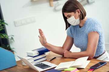 Teenage girl having online classes at home