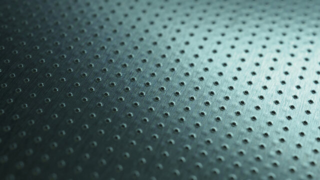 Tinted blue or green industrial metal background. Dark wallpaper. Perforated aluminum surface with many holes. Their ranks go into the distance and form a perspective. Macro