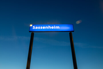 """Blue sign with the Name """"Sassenheim """" on the train station in Sassenheim South-Holland the Netherlands"""