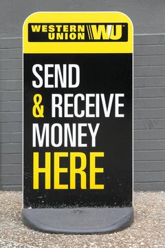 Tarare, France- June 27, 2020: Western Union sign and point. The Western Union company is an american financial services and communications company